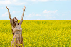 Young woman at canola field Royalty Free Stock Photo