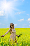 Young woman at canola field Stock Photo