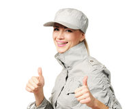 Young woman in a cap showing OK royalty free stock image
