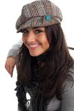 Young woman in cap smile and turn back Royalty Free Stock Images