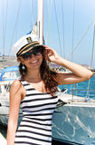 Young woman in captain cap Royalty Free Stock Image