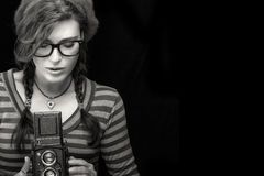 Young Woman Capturing Photo Using Vintage Camera. Monochrome Por Stock Image