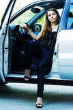 Young woman in a car. Stock Photos