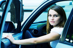 Young fashion woman in a car Stock Photography
