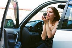 Young woman in a car. Royalty Free Stock Image