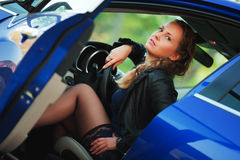 Beautiful young woman sitting in a car Stock Photos