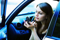 Woman with cosmetics in a car Royalty Free Stock Photography