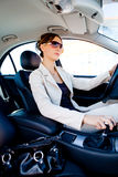 Young woman in the car 2. A young woman phoning in the car Royalty Free Stock Images