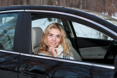 Young woman in the car Stock Image