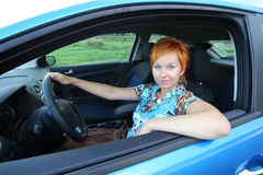 Young woman in a car stock image