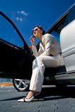 Young woman in the car. A young woman phoning in the car Royalty Free Stock Photo