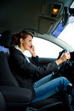 Young woman in the car. A young woman phoning in the car Stock Photos