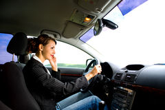 Young woman in the car. A young woman phoning in the car Stock Photography