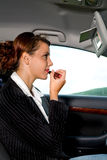 Young woman in the car. A young woman phoning in the car Royalty Free Stock Images
