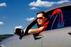 Young woman in the car Stock Images