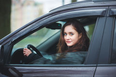 Young woman in a car Stock Images