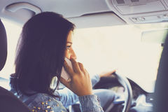 Young woman in the car with mobile phone Royalty Free Stock Photo