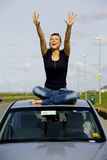 Young woman on a car royalty free stock images