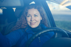 Young woman in car preparing to driving Royalty Free Stock Photo