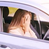 Young woman in car. Ride instruction accident. Automobile loan stock image