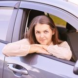 Young woman in car. Ride instruction. Automobile loan royalty free stock photography