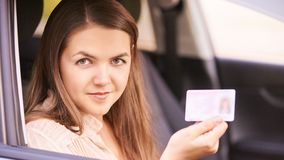 Young woman in car. Ride instruction. Automobile loan royalty free stock images