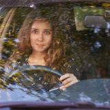 Young woman in car. Ride instruction. Automobile loan royalty free stock image