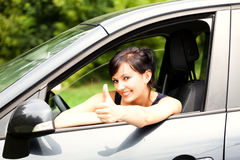 Young woman in the car with thumb up Royalty Free Stock Photo
