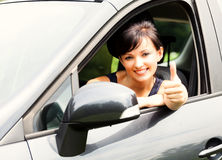 Young woman in the car with thumb up Stock Photo