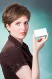 Young woman with card Royalty Free Stock Photography