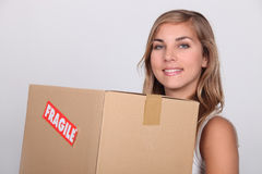 Young woman with a cardboard Royalty Free Stock Images
