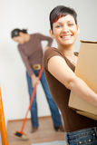 Young woman with cardboard box Royalty Free Stock Photos
