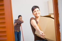 Young woman with cardboard box Stock Photos