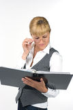 Young woman carefully studying the documents. Woman in glasses with documents Royalty Free Stock Photo
