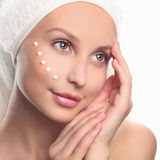 Young woman cares for face skin Royalty Free Stock Image