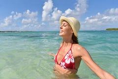 Young woman in caribbean sea enjoying Royalty Free Stock Image