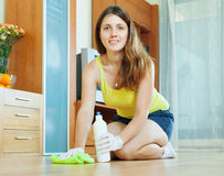 Young woman caring for parquet Stock Photography
