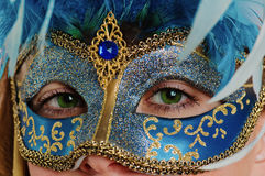 Young woman in a carnival  mask Royalty Free Stock Photography