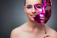 The young woman with carnival mask Royalty Free Stock Photography