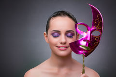 The young woman with carnival mask Royalty Free Stock Photo