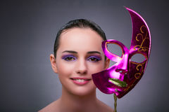 The young woman with carnival mask Stock Images