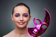 The young woman with carnival mask Royalty Free Stock Photos