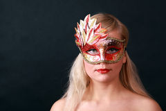 Young woman with carnival mask on her face Royalty Free Stock Images
