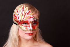 Young woman with carnival mask on her face Royalty Free Stock Image