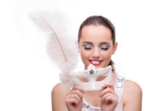 The young woman with carnival mask isolated on white. Young woman with carnival mask isolated on white Royalty Free Stock Photography