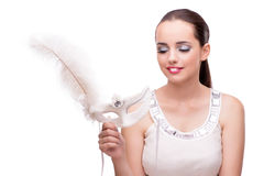 The young woman with carnival mask isolated on white. Young woman with carnival mask isolated on white Royalty Free Stock Image
