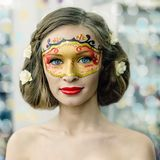 Young woman in a carnival mask Stock Photos