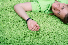Young woman on carpet Stock Image