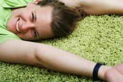 Young woman on carpet Stock Photos