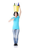 Woman carrying a bin with recyclable glass bottles. Stock Photography